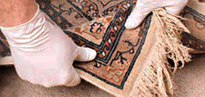 Pegado y cosido de alfombras